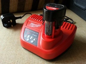 Milwaukee battery charger and REDLITHIUM-ION battery