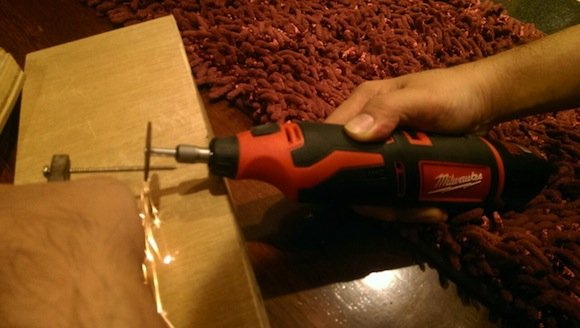 Milwaukee Rotary Tool cutting a screw