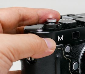 prevent soft shutter release button from falling off