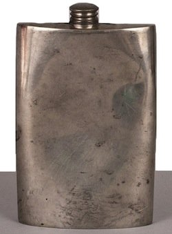 A squashed hip flask sold at an online auction site